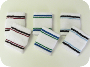 white tennis wristbands with lines all