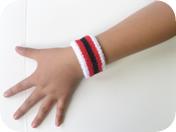children's striped wrist band on hand