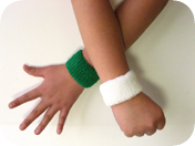 children's green and white wristband wearing view